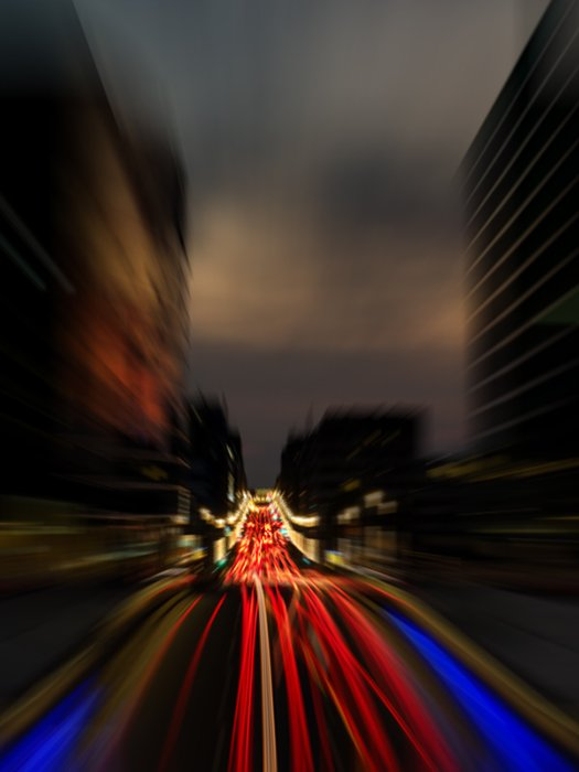 A blurry light trail photo using a radial blur filter in photoshop with the zoom blur to simulate zoom blurring for more artistic images.