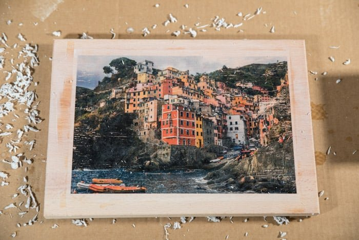 The final image - colourful coastal town photo transferred to a wooden board