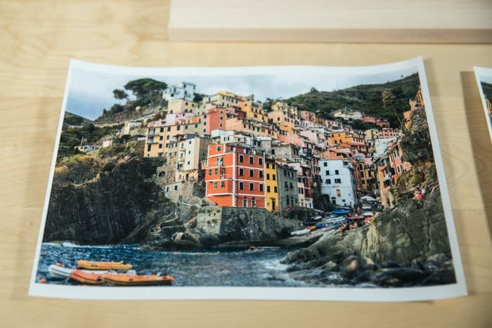 A photo of a brightly colored coastal town, resting on a wooden board