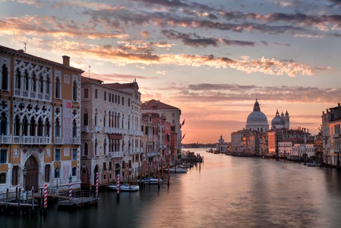 A serene photo of Venice buildings and water used digital blending to balance the exposure across the frame.