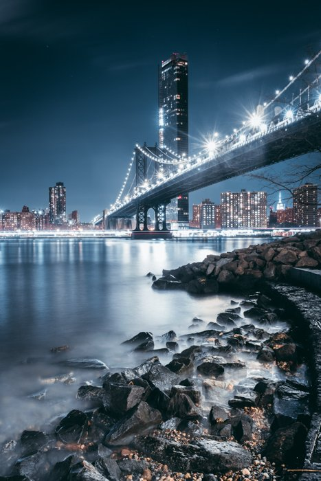 Nighttime image of a bridge with lights