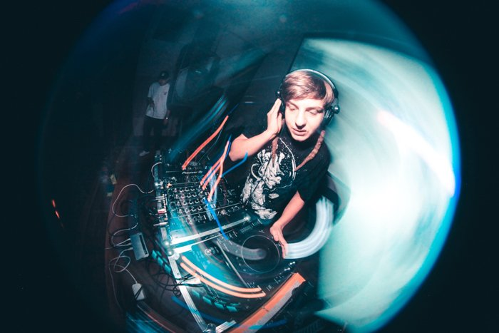 Fish eye image of a DJ at a night event