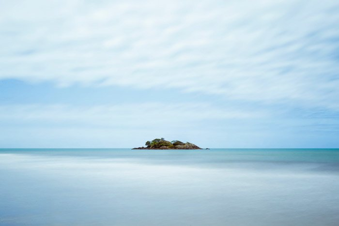 serene seascape with an island in the distance