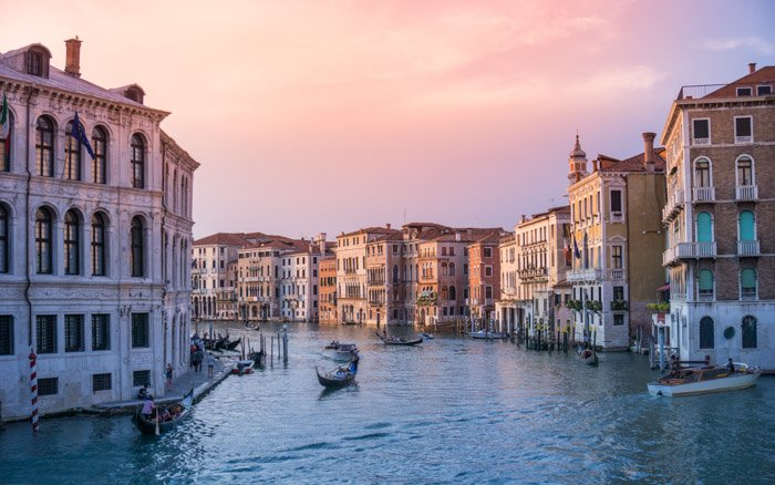 serene travel photo of the canals in Venice at sunset