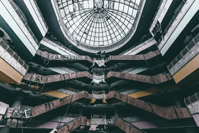 Interesting urban exploration shot of the interior of a multi leveled abandoned building