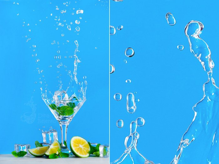 Dynamic water splash photography with a glass of mojito or lemonade on a bright blue background. Refreshing summer drink concept with copy space.
