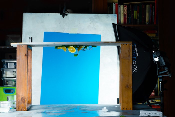 A creative food photography set up, the still life is upside down ready for trying water splash photography