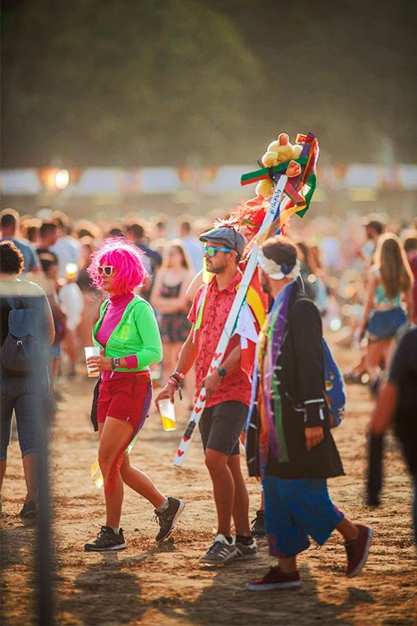 Photo of colorfully dressed festival goers with good bokeh background