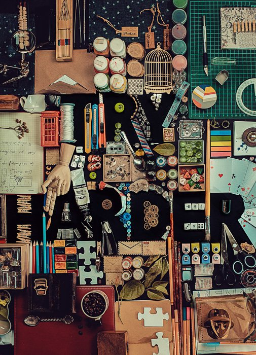 A creativestill life with the silhouette of the word 'Try Harder' comprised of many small objects