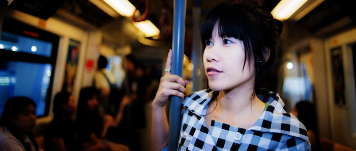 Portrait of a girl standing on a train