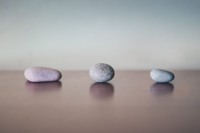 composition: photo of three stones placed in a line