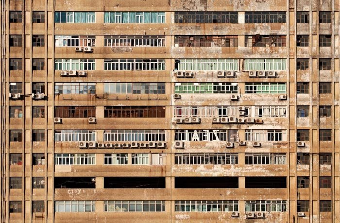 The exterior of a run down industrial building or apartment block