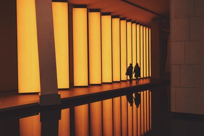 The interior of an impressive orange lit building