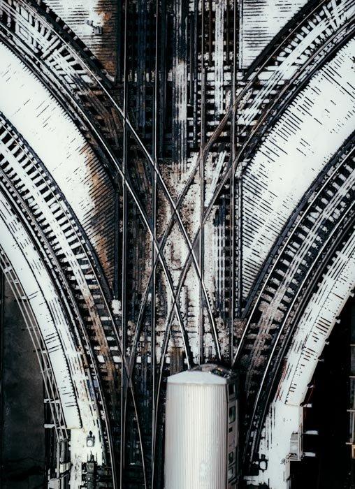 An overhead shot of crossed railway lines