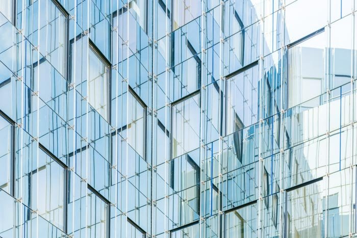 A photo of the exterior of a multi windowed glass building