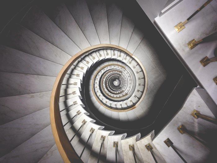 A photo looking down an elaborate spiral staircase