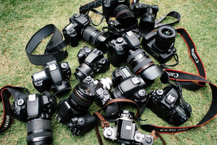 A overhead shot of 13 different types of best camera for portraits on grass