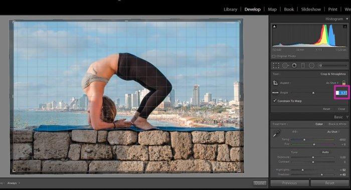 using the grid in lightroom to align a photo of a woman in a yoga pose on a stone brick wall