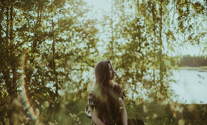 Beautiful outdoor portrait of a long haired female model - ambient light for better portraits