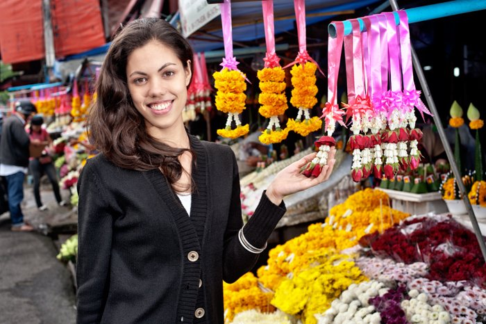 Young woman at the flower market in Chiang Mai, Thailand