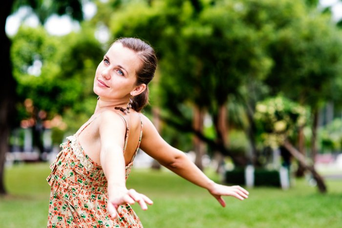 Beautiful young woman in the park enjoying life, example of editorial portrait photography.