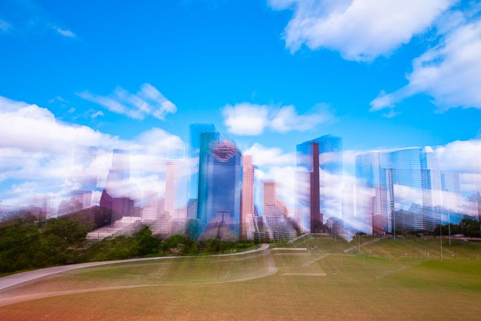 City buildings against a bright sky shot with slow shutter for blurring effect