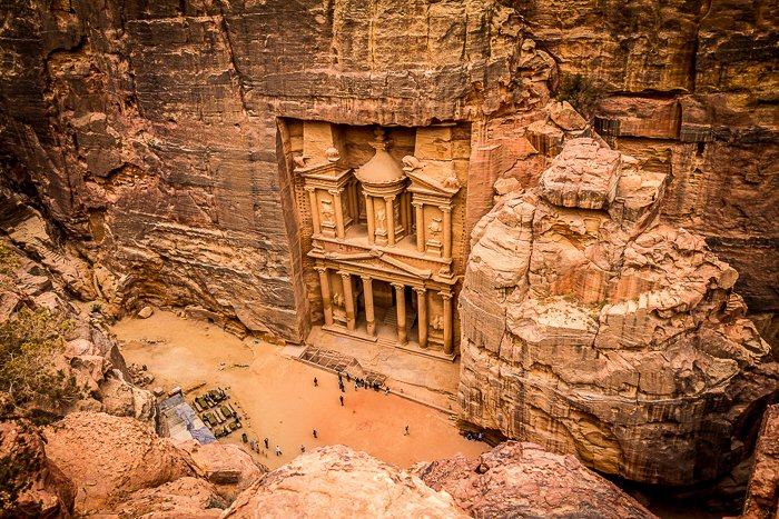 photo looking down at the carved pillars of Petra in Jordan