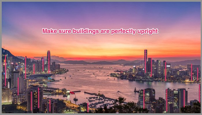 A fantastically coloured cityscape with the message 'make sure buildings are perfectly upright'.