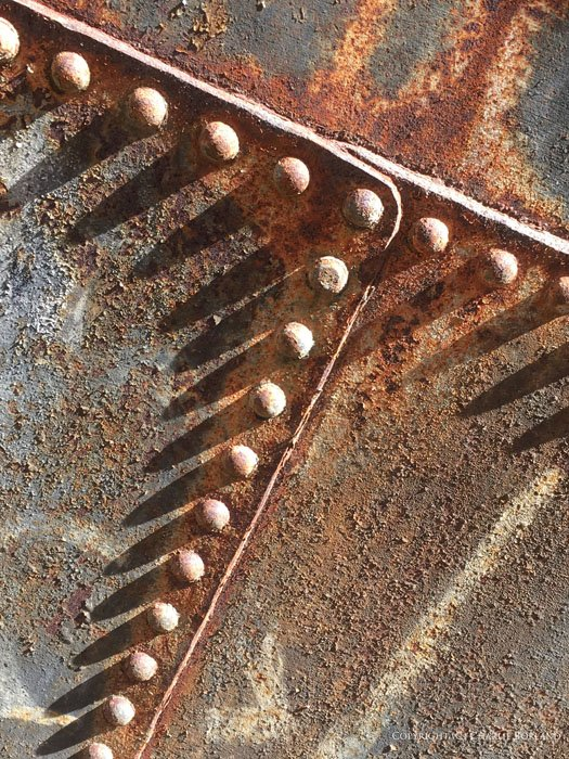 A close up of rusty metallic machinery part taken with iPhone photography camera