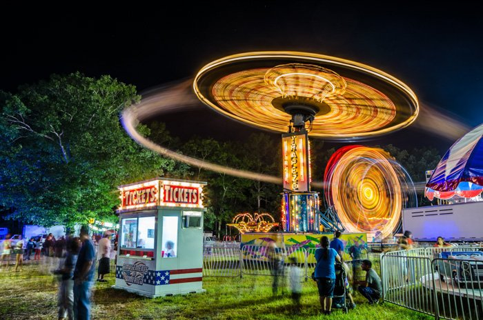 Atmospheric shot of a fairground ride at night