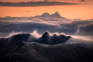 Reddening of the sky over a seas of clouds in the majestic Dolomites.