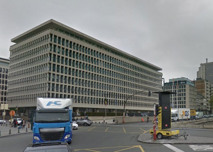 photograph of a seemingly boring rectangular building with lots of windows