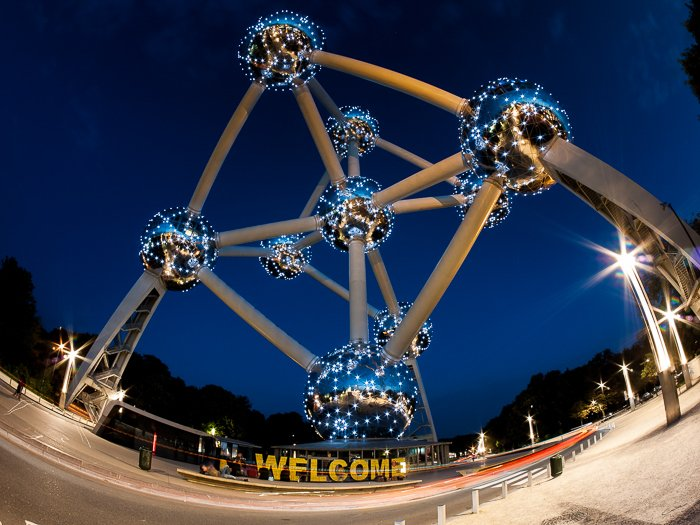 fish eye photo of The Atomium from the bottom, against a deep blue night sky
