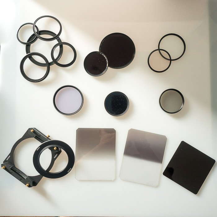 An overhead shot of Filters used in landscape photography includes neutral density filters, polarisers and graduated density filters with holder.