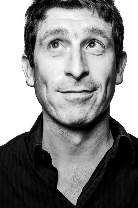 Black and white headshot of a man in Platon style