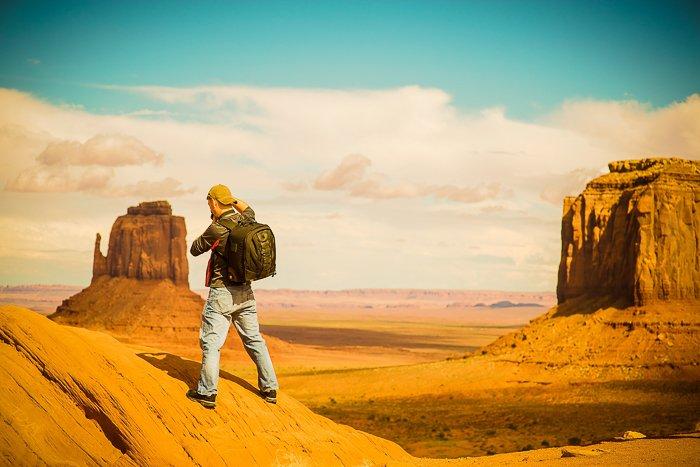 A backpacker standing in an impressive desert landscape