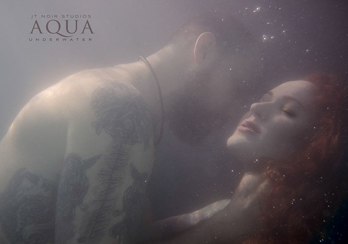 Sensual advertising image of a couple embracing underwater