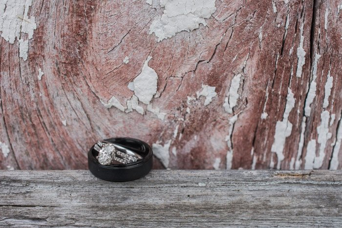 A close up shot of two wedding rings on a wooden background