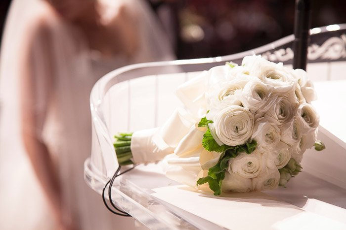 A close up shot of a wedding bouquet with bokeh background