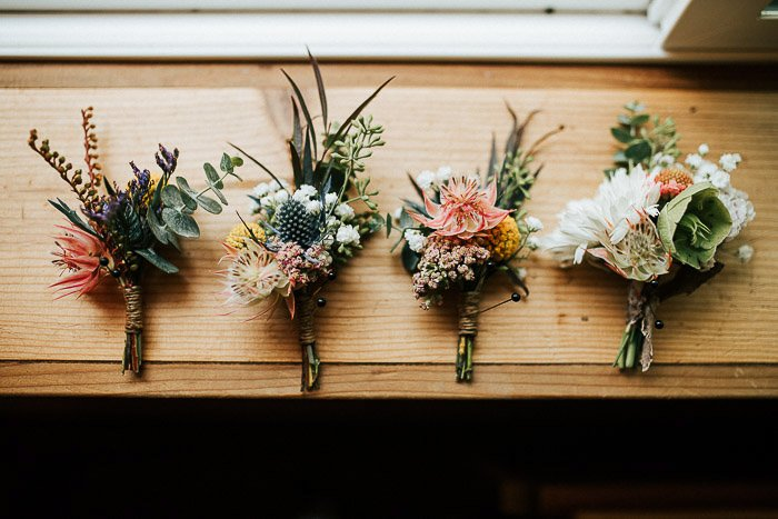 Still life of four wedding flower bouquets on a wooden surface