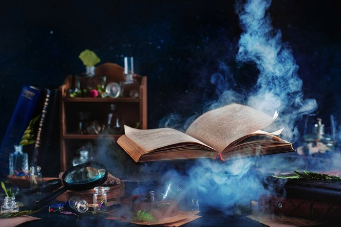 Flying magical book with smoke - still life using colors that contrast with blue