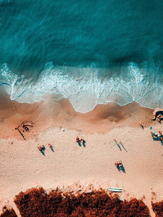 An aerial view of a beach using the color scheme orange and blue