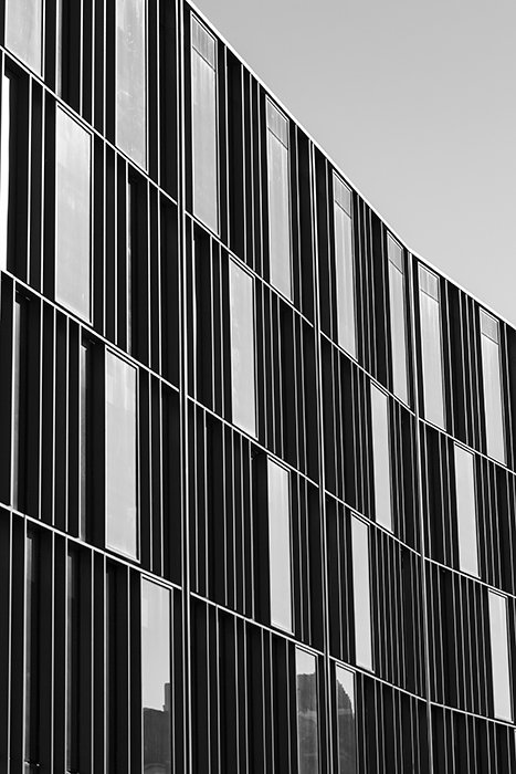 A monochrome photo of a multiwidowed building - best camera settings for black and white photos