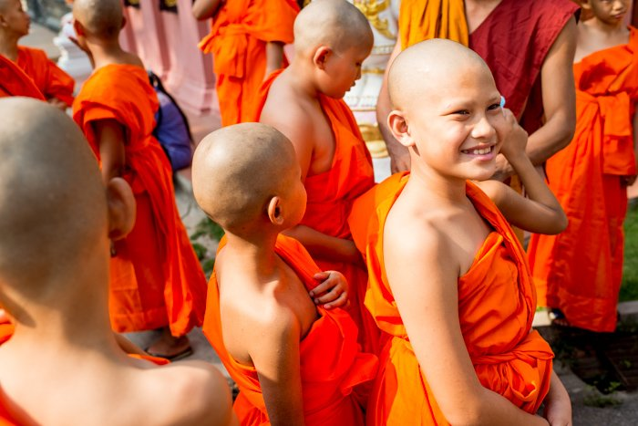A group of young novice monks smiling