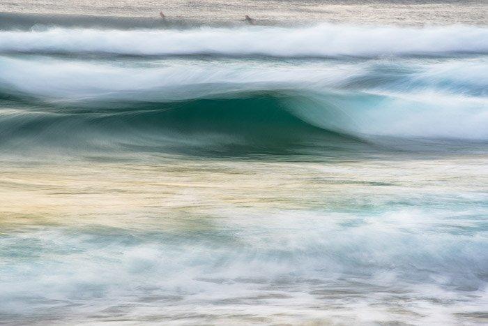 abstract seascape taken using long exposure ocean photography, blue green sea, foamy waves