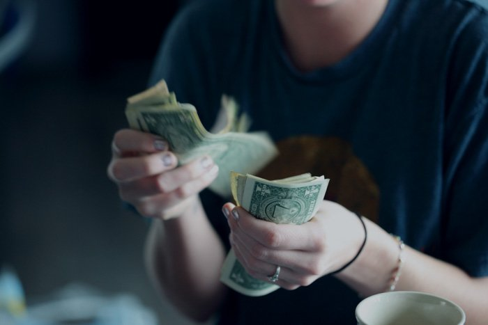 A close up of a person counting money