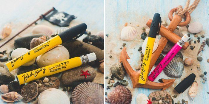close up photos of art markers on stones, shells on beach sand photo background
