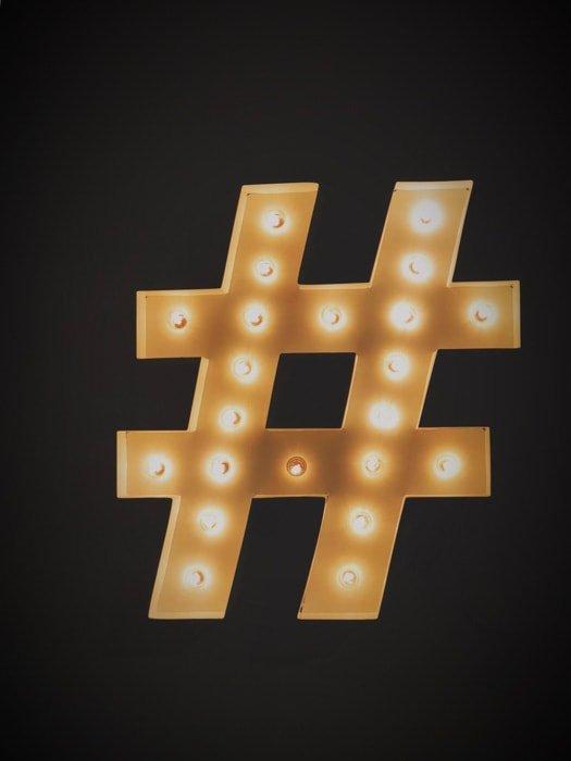 A golden instagram hashtag on black background