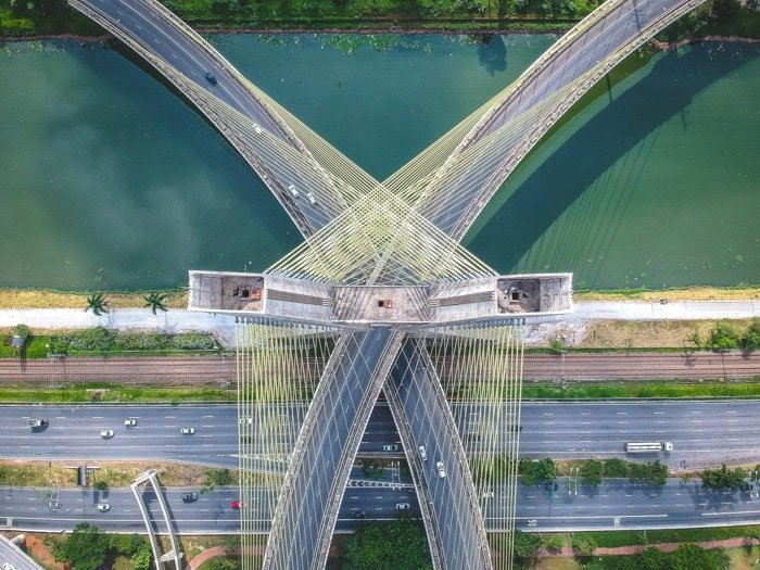 A stunning aerial photograph of traffic on two bridges over a river