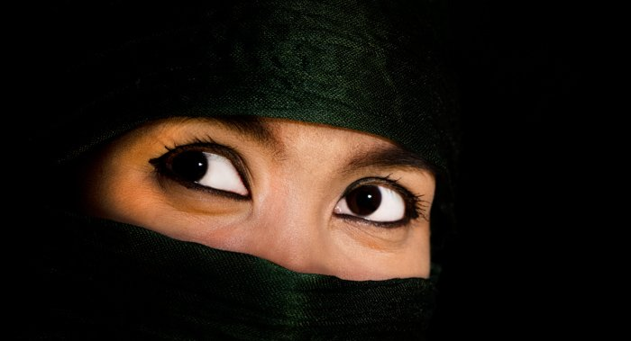 Close up of beautiful dark eyes of an Asian Woman. - using photography props